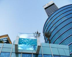 Curved pool panel extends beyond roofline at high end hotel in Dubai.